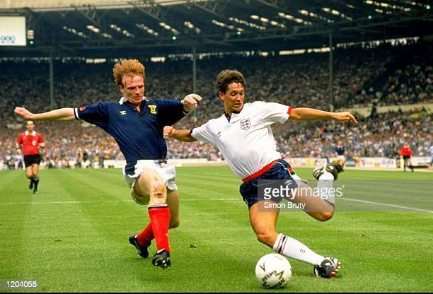 Gary Lineker of England is challenged by Alex McLeish of Scotland during the Rous Cup Match at Wembley Stadium in London England England won 10...
