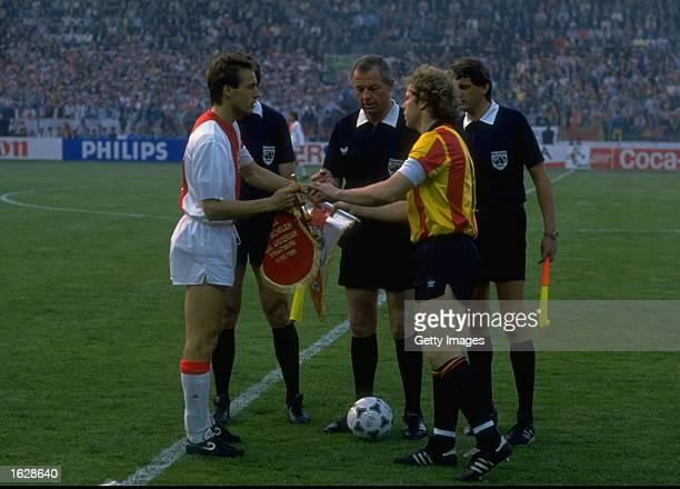 Johnny Vant Schip of Ajax and Leo Clijsters of Mechelen exchange pennants before the European Cup Winners Cup final at the Stade de la Meinau in...