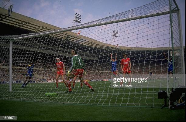 Lawrie Sanchez of Wimbledon raises his arms aloft in celebration after beating Liverpool goalkeeper Bruce Grobbelaar to score the winning goal during...