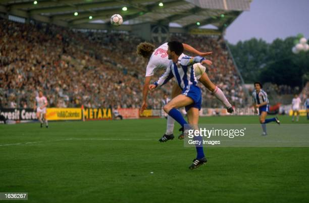 Reinhardt of Bayer Leverkusen and Alonso of Espanol jump to head the ball during the UEFA Cup Final Second Leg match at the Ulrich Haberland Stadium...