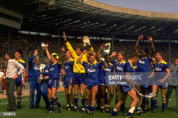 The Wimbledon team salute their supporters after their victory in the FA Cup final against Liverpool at Wembley Stadium in London Wimbledon won the...