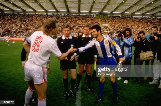 W Rolf of Bayer Leverkusen and Alonso of Espanol the team captains shake hands before the UEFA Cup Final Second Leg match at the Haberland Stadium in...