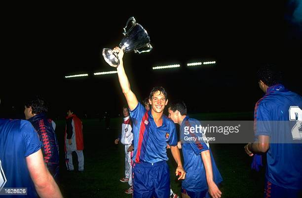 Gary Lineker of Barcelona holds the trophy aloft in celebration after their victory in the European Cup Winners Cup final against Sampdoria at the...