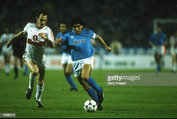 Hartmann of Stuttgart moves in to tackle Diego Maradona of Napoli during the UEFA Cup Final Second Leg match at the Neckarstadion in Stuttgart...