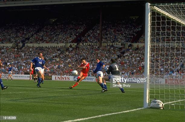 Ian Rush of Liverpool beats goalkeeper Neville Southall of Everton to score their second goal during the FA Cup final at Wembley Stadium in London...