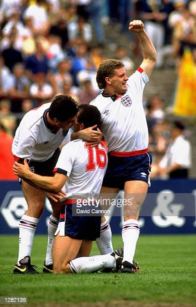 Neil Webb Steve Bull and Paul Gascoigne of England celebrate after Bull scores during the Rous Cup match against Scotland at Hampden Park in Glasgow...
