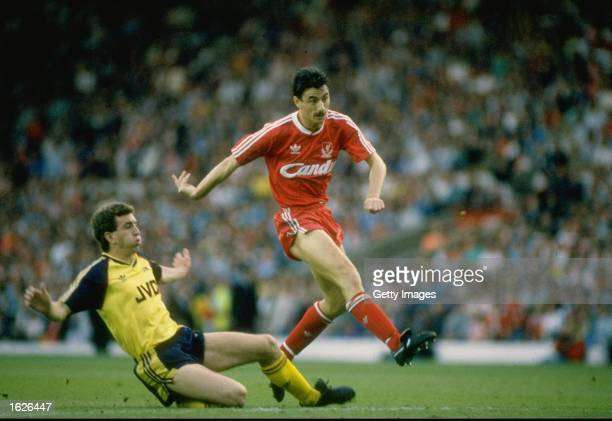 Nigel Winterburn of Arsenal tackles Ian Rush of Liverpool during the League Division One match at Anfield in Liverpool England Arsenal won the match...