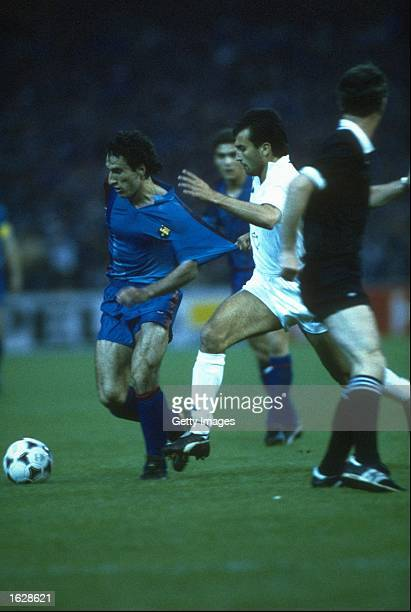 Pellegrini of Sampdoria holds back Berguirstain of Barcelona during the European Cup Winners Cup final at the Wankdorf Stadium in Berne Switzerland...