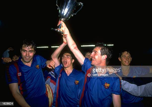 Roberto of Barcelona holds the trophy aloft and celebrates with his team mates including Gary Lineker after their victory in the European Cup Winners...