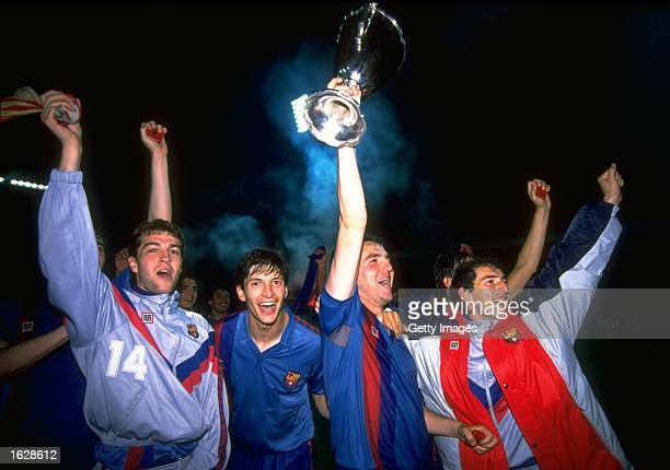 Roberto of Barcelona holds the trophy aloft as he celebrates with his team mates after their victory in the European Cup Winners Cup final against...