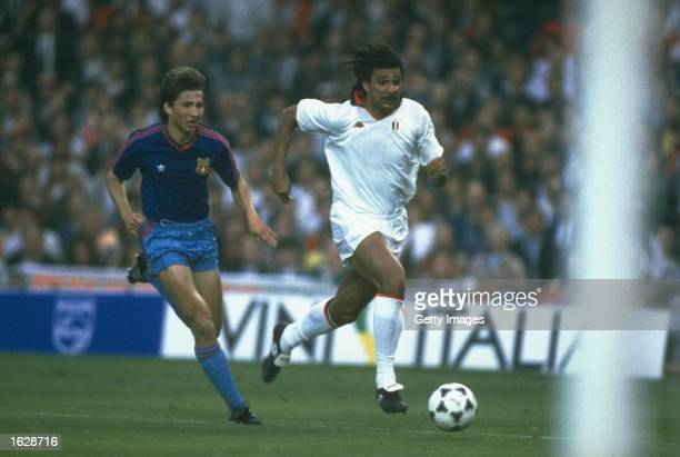 Ruud Gullit of AC Milan gets away from Dan Petrescu of Steaua Bucherest during the European Cup final at the Nou Camp Stadium in Barcelona Spain AC...
