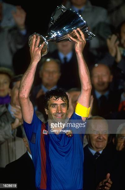 Team Captain Alexanco of Barcelona holds the trophy aloft after their victory in the European Cup Winners Cup final against Sampdoria at the Wankdorf...