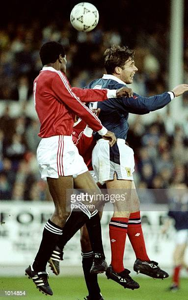 Ally McCoist of Scotland jumps for the ball with Rabei Yassin of Egypt during a Friendly match at the Pittodrie Stadium in Aberdeen Scotland Egypt...