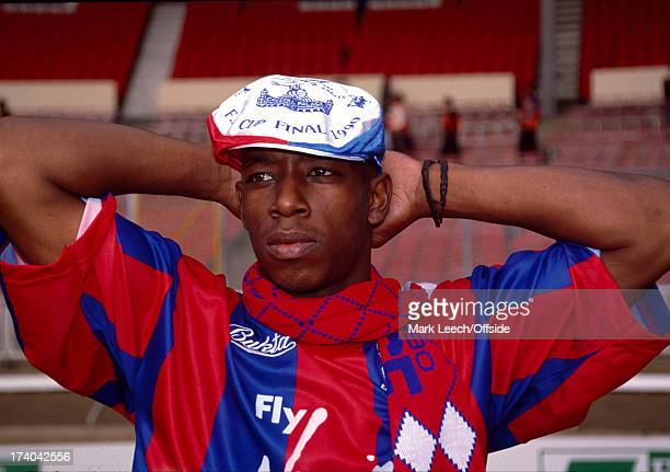 12 May 1990 FA Cup Final Ian Wright wearing a Crystal Palace hat and scarf stands in the empty stadium after the match in which he scored two goals...