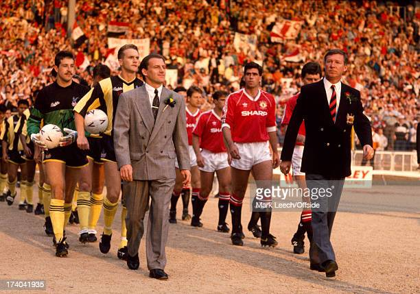 17 May 1990 FA Cup final replay Crystal Palace v Manchester United Palace manager Steve Coppell leads out his Palace team alongside Alex Ferguson in...