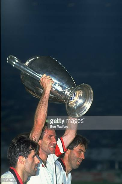 Franco Baresi of AC Milan holds the trophy aloft after their victory in the European Cup final against Benfica at Prater in Vienna Austria AC Milan...