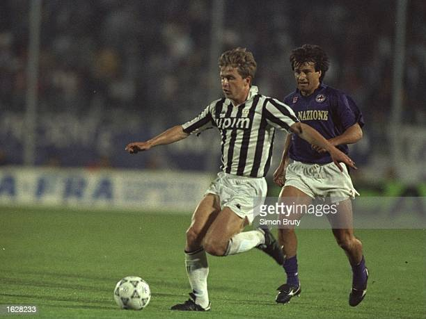 Giancarlo Marocchi of Juventus is pursued by Dunga of Fiorentina during the UEFA Cup Final second leg match in Avellino Italy The match ended in a 00...