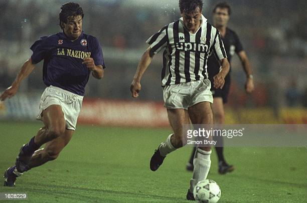 Gianluigi Casiraghi of Juventus is put under pressure by Dunga of Fiorentina during the UEFA Cup Final second leg match in Avellino Italy The match...