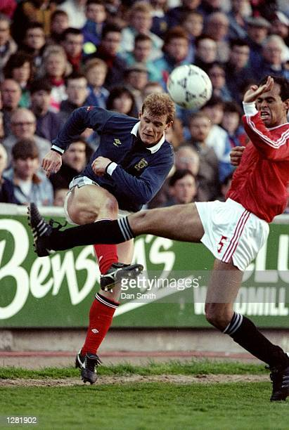 Hisham Yaken of Egypt takes on Gordon Durie of Scotland during a Friendly match at the Pittodrie Stadium in Aberdeen Scotland Egypt won the match 31...