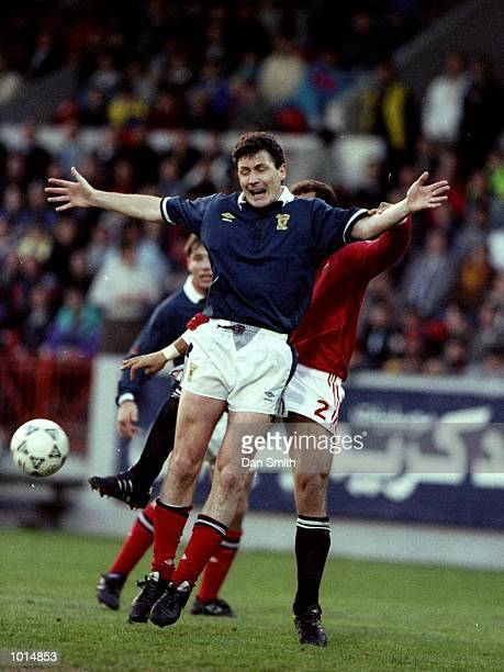 Jim Bett of Scotland shields the ball from Ibrahim Hassan of Egypt during a Friendly match at the Pittodrie Stadium in Aberdeen Scotland Egypt won...