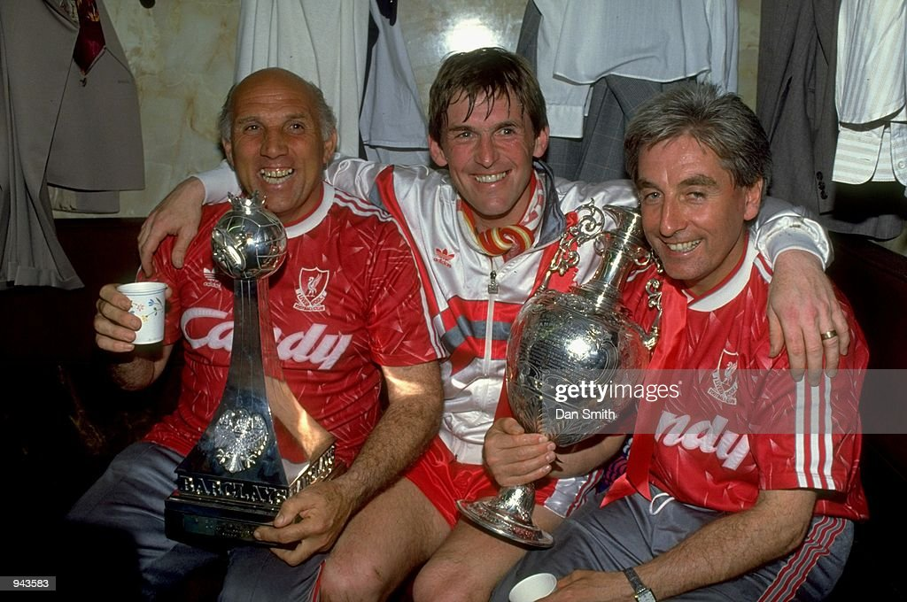 Liverpool Manager Kenny Dalglish celebrates with coaches Ronnie Moran and Roy Evans after the Barclays League Division One match against Derby County at Anfield in Liverpool, England. Liverpool won the match 1-0 and became league champions.\ Mandatory Credit: Dan Smith /Allsport