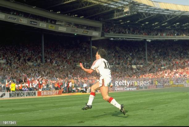 Mark Hughes of Manchester United celebrates after he scores his second goal during the FA Cup final against Crystal Palace at Wembley Stadium in...