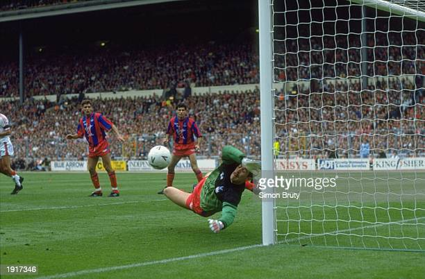 Nigel Martyn of Crystal Palace makes a great save during the FA Cup final against Manchester United at Wembley Stadium in London The match ended in a...