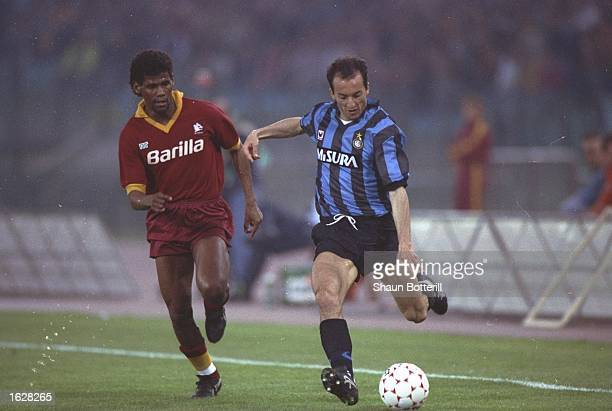 Fausto Pizzi of Inter Milan crosses the ball before Aldair of AS Roma can tackle him during the UEFA Cup Final second leg match at the Stadio...