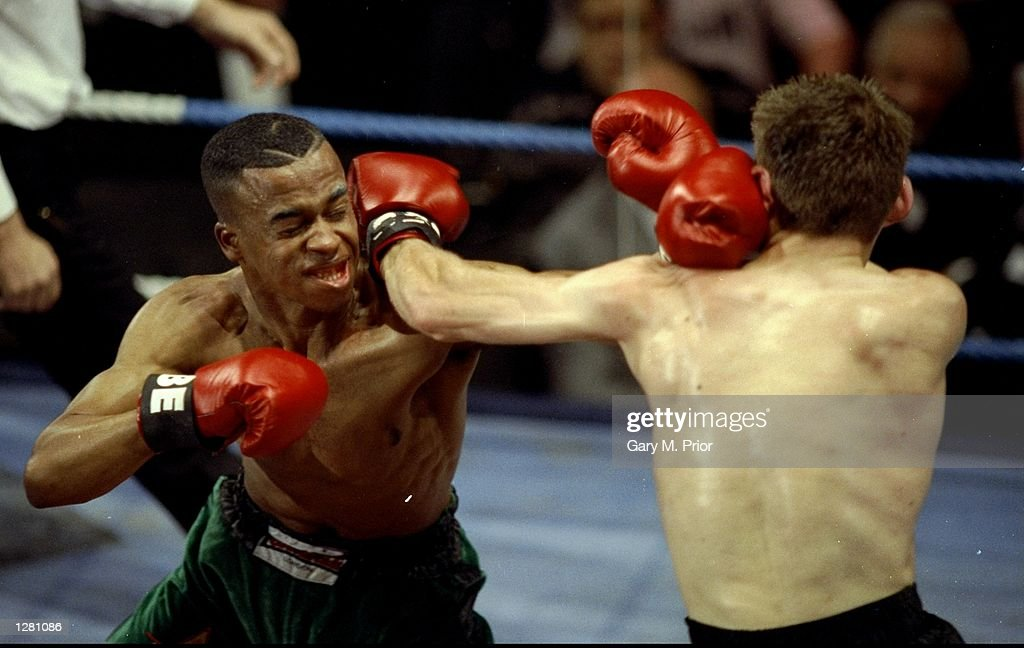 Kelton McKenzie of Great Britain exchanges blows with Tim Yeates during a Featherweight bout in Bethnal Green, London. McKenzie won the bout on points. \ Mandatory Credit: Gary M. Prior/Allsport