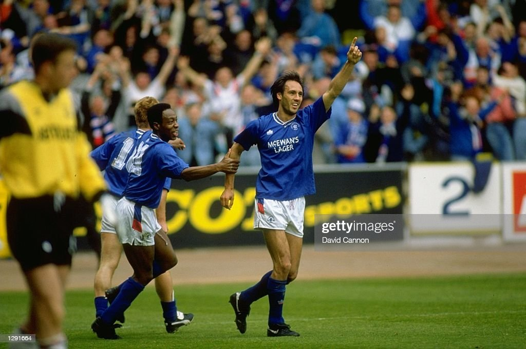 Mark Walters (left) and Mark Hately (right) of Rangers celebrate after their victory in the Scottish Premier League match against Aberdeen at the Ibrox Stadium in Glasgow, Scotland. Rangers won the match 2-0. \ Mandatory Credit: David Cannon/Allsport