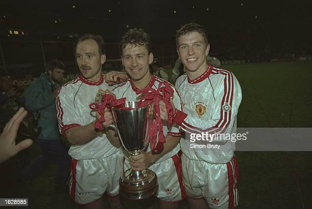 Michael Phelan Bryan Robson and Lee Sharpe of Manchester United celebrate with the Trophy after their victory in the European Cup Winners Cup Final...