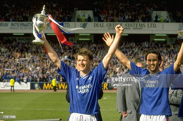 Nigel Spackman and Mark Hately of Rangers hold their trophies aloft after winning the Scottish Premier League match against Aberdeen at the Ibrox...