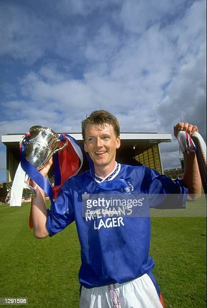 Nigel Spackman of Rangers celebrates with the trophy after winning the Scottish Premier League match against Aberdeen at the Ibrox Stadium in Glasgow...