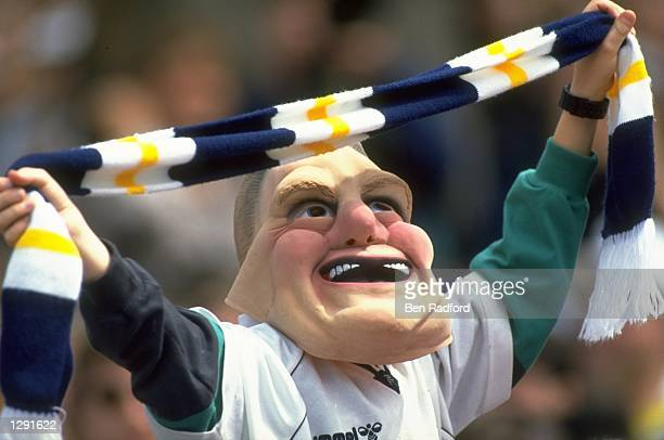 Portrait of a Tottenham Hotspur supporter wearing a 'Gazza' mask and waving his scarf during the FA Cup Final against Nottingham Forest at Wembley...