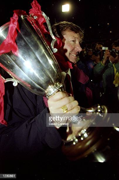 Portrait of Manchester United Manager Alex Ferguson with the trophy after the European Cup Winners Cup final against Barcelona at the Feyenoord...