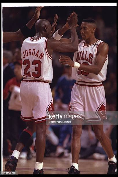 Chicago Bulls guard Michael Jordan and forward Scottie Pippen celebrate during Game Five of the Eastern Conference finals against the Cleveland...