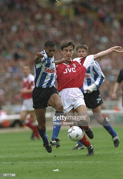 Carlton Palmer of Sheffield Wednesday holds off Alan Smith of Arsenal during the FA Cup final at Wembley Stadium in London The match ended in a 11...