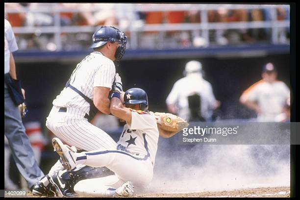 Catcher Dan Walters of the San Diego Padres tries to tag out Andujar Cedeno of the Houston Astros during a game at Jack Murphy Stadium in San Diego...