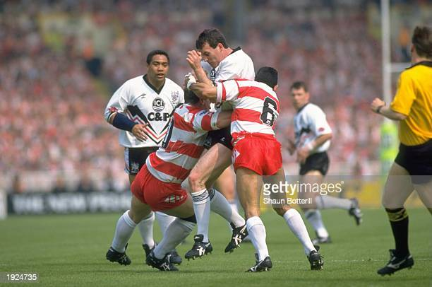 Darren Wright of Widnes is tackled by Frano Botica of Wigan during the Challenge Cup final at Wembley Stadium in London. \ Mandatory Credit: Shaun...