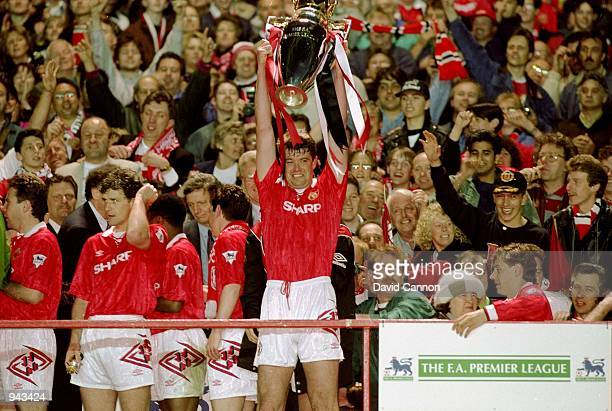 Gary Pallister of Manchester United lifts the FA Carling Premier League trophy after their 31 win over Blackburn Rovers at Old Trafford in Manchester...