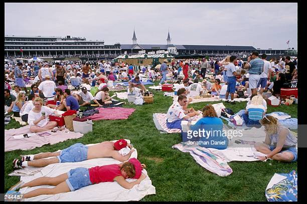 General view of spectators in the infield during the Kentucky Derby at Churchill Downs in Louisville Kentucky Mandatory Credit Jonathan Daniel...