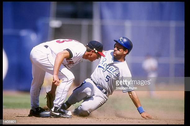 Infielder George Brett of the Kansas City Royals and Gary Disarcina of the California Angels in action during a game at Anaheim Stadium in Anaheim...