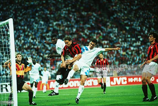JeanPierre Papin of Milan is challenged by marcel Desailly and JeanChristophe Thomas of Marseille during the European Cup Final played between AC...