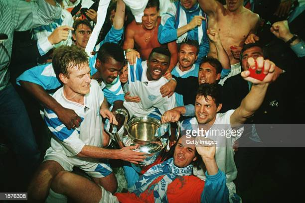 Marseille players celebrate after their victory over AC Milan in the European Cup Final played at the Olympic Stadium Munich Marseille won the match...