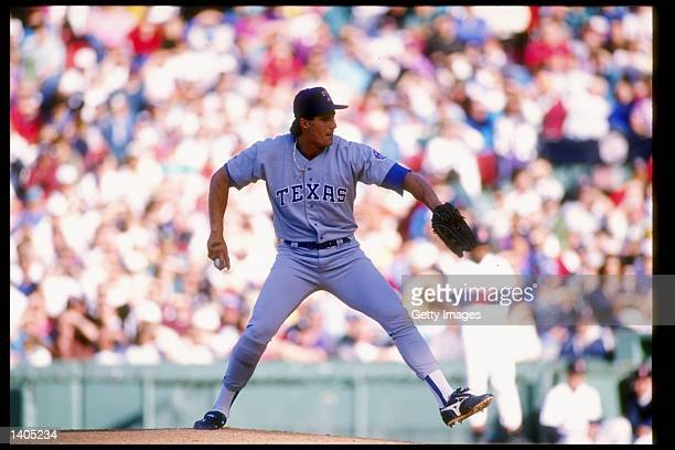 Pitcher Jose Canseco of the Texas Rangers prepares to throw the ball during a game against the Boston Red Sox at Fenway Park in Boston Massachusetts...