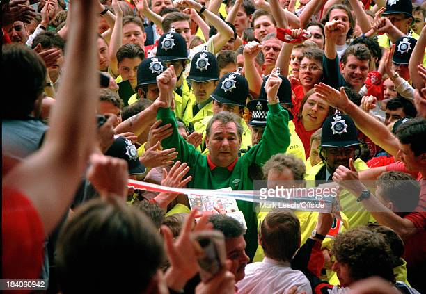 01 May 1993 Premier League Nottingham Forest v Sheffield United Police hold back the Forest fans as they invade the pitch to say goodbye to their...