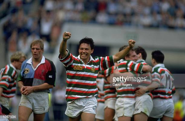 Rory Underwood of Leicester celebrates his team's victory as a dejected Peter Winterbottom of the Harlequins looks on after the Pilkington Cup Final...