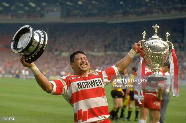 Sam Panapa of Wigan holds the trophy aloft after the Challenge Cup final against Widnes at Wembley Stadium in London Mandatory Credit Shaun...