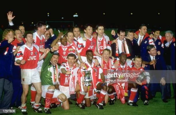 The Arsenal team celebrate with the trophy after winning the FA Cup Final against Sheffield Wednesday at Wembley Stadium in London Arsenal won the...