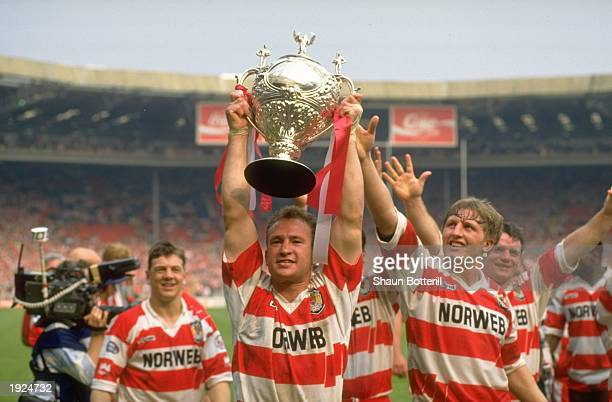 Wigan Captain Dean Bell holds the trophy aloft after the Challenge Cup final against Widnes at Wembley Stadium in London Mandatory Credit Shaun...
